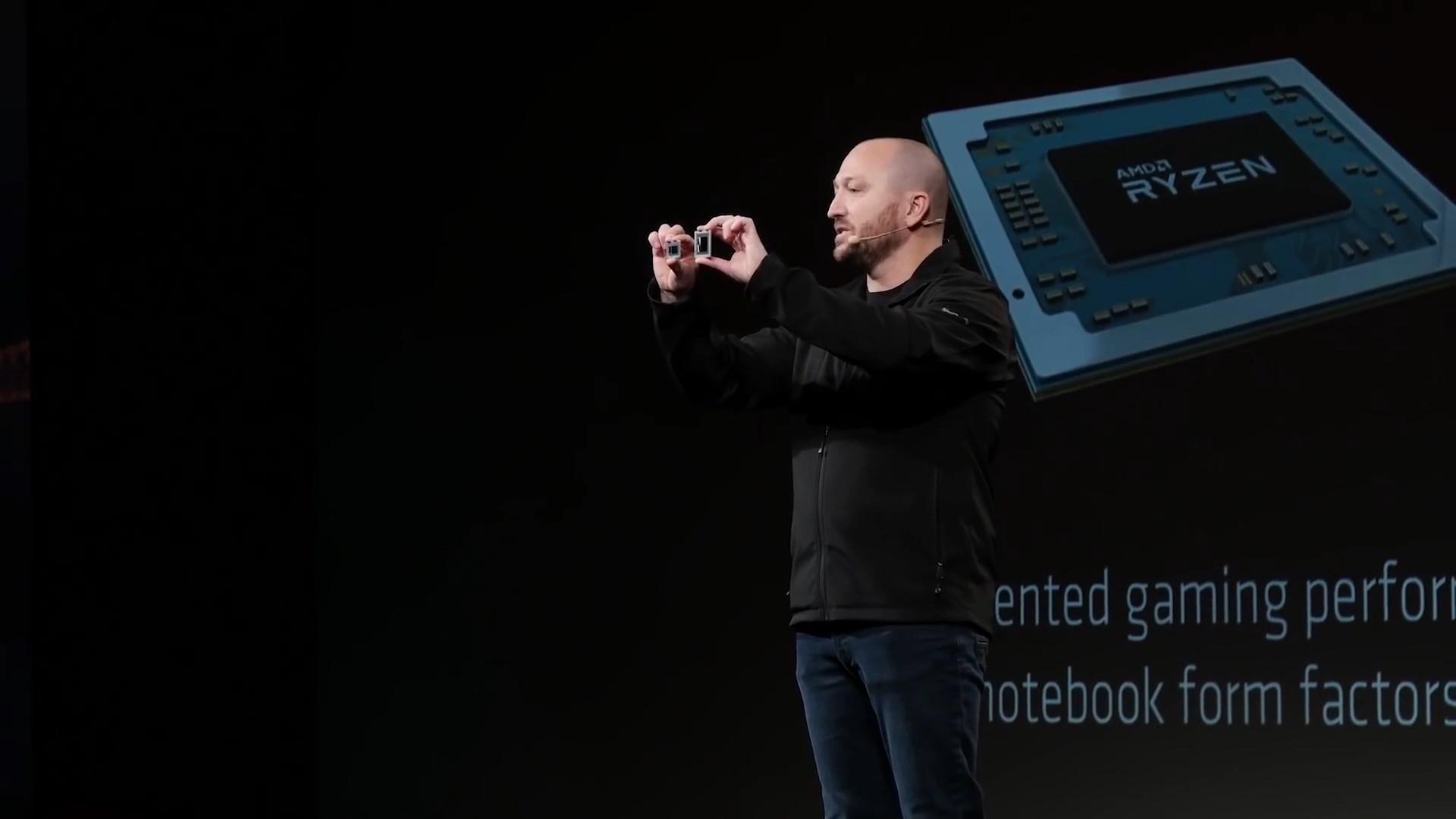 Фотография с презентации интегрированных и дискретных графических чипов Vega: Скотт Херкельман (Scott Herkelman ) рассказывает о планах компании на фоне слайда с графиком выхода обновлённых архитектур Zen
